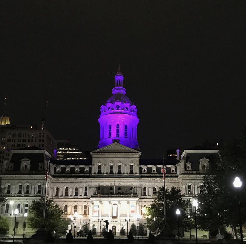 Baltimore City Hall building Lit up in purple
